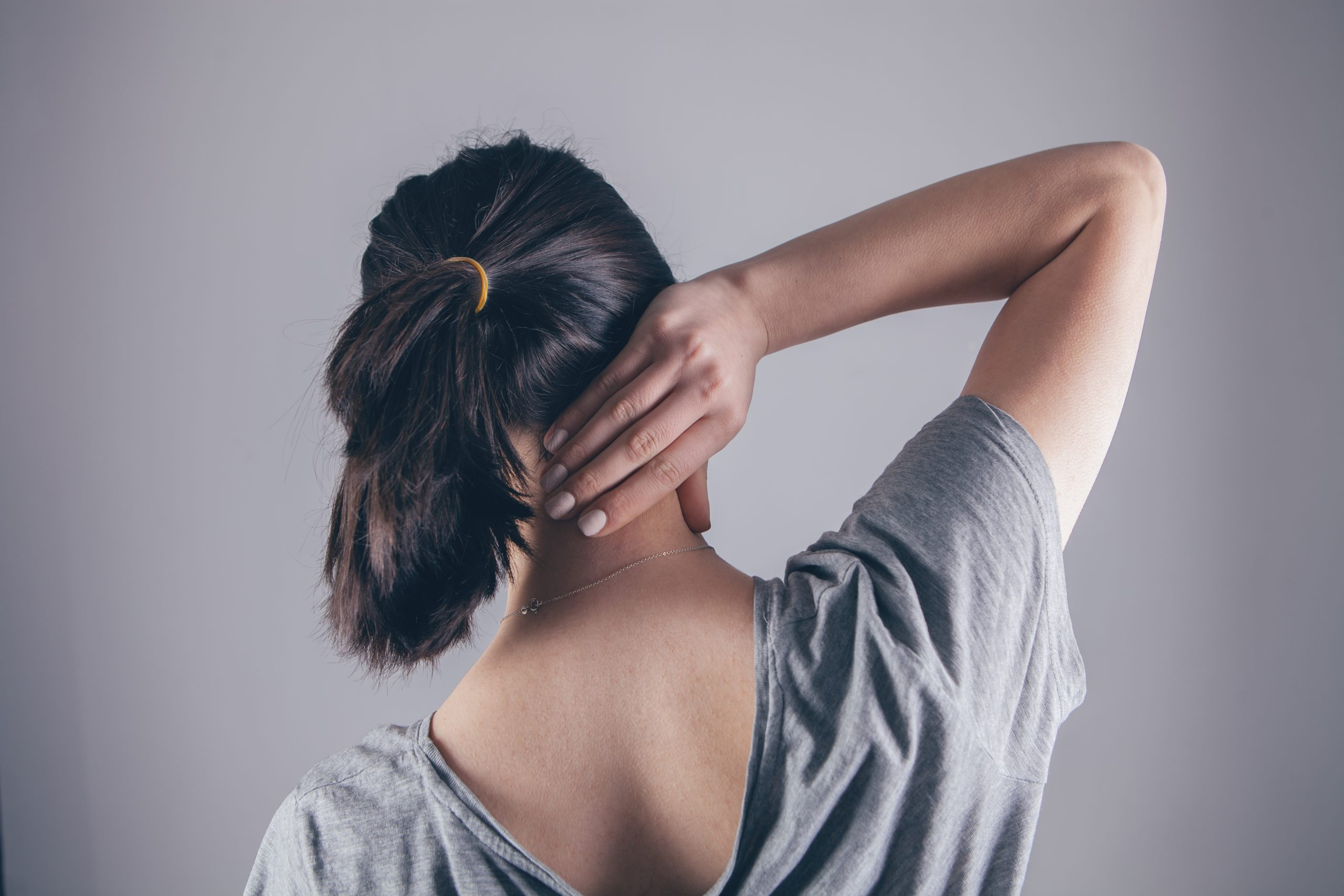close-up on a woman's hand massaging her neck. Girl's neck hurts